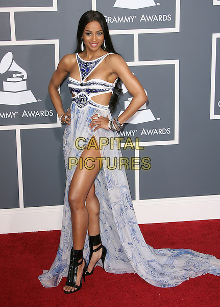 CIARA (Ciara Princess Harris).The 53rd Annual GRAMMY Awards held at the Staples Center, Los Angeles, California, USA..February 13th, 2011.arrivals grammys full length purple cut out dress halterneck long maxi hands on hips black sandals white print open toe ruffle away slit split bracelets.CAP/ADM.©AdMedia/Capital Pictures.
