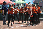 The Douglas Tigers greet Corry Diaz at the plate after she hit a home run against the Galena Grizzlies in a first round game of the NIAA northern region softball tournament in Reno, Nev., on Thursday, May 15, 2014. <br /> Photo by Cathleen Allison
