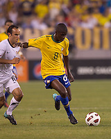 Brazil midfielder Ramires (8) dribbles as USA midfielder Landon Donovan (10) closes. Brazil  defeated the US men's national team, 2-0, in a friendly at Meadowlands Stadium on August 10, 2010.