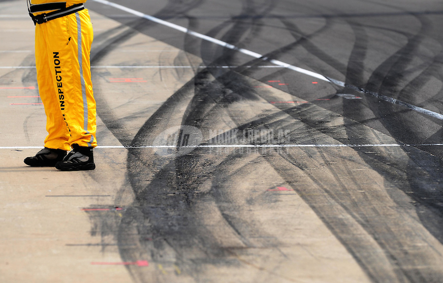 May 24, 2009; Indianapolis, IN, USA; Tire tracks leave a pit stall on pit road during the 93rd running of the Indianapolis 500 at Indianapolis Motor Speedway.  Mandatory Credit: Mark J. Rebilas-