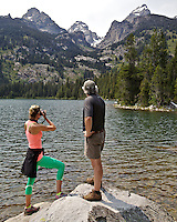 Hikers pause for a photo at Bradley Lake in Grand Teton National Park.