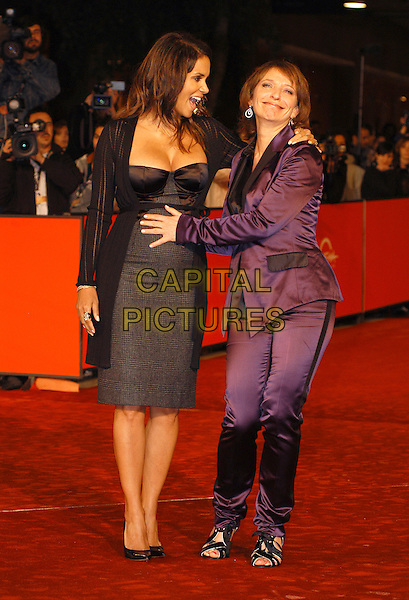"HALLE BERRY & SUSANNE BIER.Red carpet arrivals for the film ""Things We Lost In The Fire"" during the 2nd Annual Rome Film Festival, Rome, Italy, 26th October 2007. .full length black grey tartan plaid print dress pregnant purple trouser suit hand on bump tummy.CAP/CAV.©Luca Cavallari/Capital Pictures."