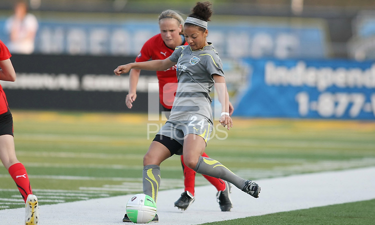 Philly defender Estelle Johnson (24) plays the ball back to a teammate as Atlanta defender Stacy Bishop (4) approaches.  Atlanta and Philadelphia played to a 0-0 draw in the season opener for both teams at John A Farrell Stadium in West Chester, PA.