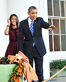 United States President Barack Obama, waves to one of the guests after pardoning the National Thanksgiving Turkey, Liberty, in a  ceremony on the North Portico of the White House in Washington, D.C. on Wednesday, November 23, 2011.  Liberty, a 19-week old, 45-pound Turkey will live out its life at George Washington's Mount Vernon Estate and Gardens in Mount Vernon, Virginia.  At left is Malia Obama..Credit: Ron Sachs / CNP.(RESTRICTION: NO New York or New Jersey Newspapers or newspapers within a 75 mile radius of New York City)
