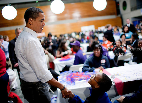 Washington, DC - January 19, 2009 -- United States President-elect Barack Obama greets a boy at Calvin Coolidge High School where students, military families, and volunteer service groups are working on various projects supporting the troops  in Washington, D.C., U.S., Monday, January 19, 2009.  .Credit: Joshua Roberts - Pool via CNP