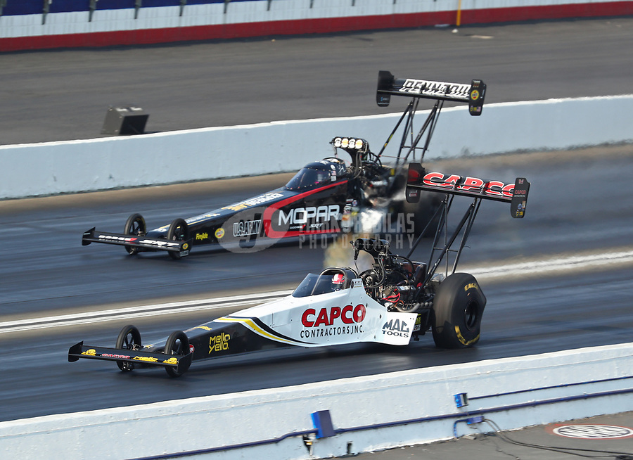 Nov 10, 2018; Pomona, CA, USA; NHRA top fuel driver Steve Torrence (near) races alongside Leah Pritchett during qualifying for the Auto Club Finals at Auto Club Raceway. Mandatory Credit: Mark J. Rebilas-USA TODAY Sports
