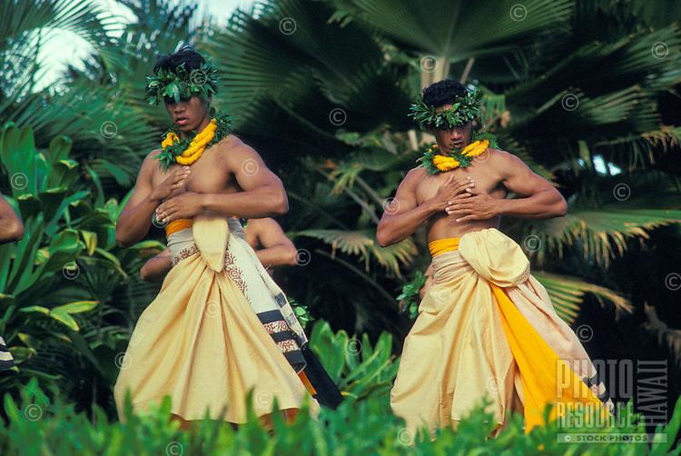 EDITORIAL ONLY. Men performing hula at Lanikuhonua, Oahu