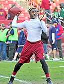 Washington Redskins quarterback Robert Griffin III (10) warms-up prior to the an NFC Wild-card play-off game against the Seattle Seahawks at FedEx Field in Landover, Maryland on Sunday, January 6, 2013..Credit: Ron Sachs / CNP
