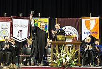 "Ron Hall, left, rings a cowbell presented to him Tuesday [August 18] by MSU President Mark E. Keenum, right, during the university's second Freshman Convocation. Hall, co-author of the university's 2015 Maroon Edition common reading experience selection, ""Same Kind of Different as Me,"" shared life lessons with the more than 3,400 freshmen in attendance, who make up the largest class in the 137-year-old land-grant university's history. (photo by Beth Wynn / © Mississippi State University)"