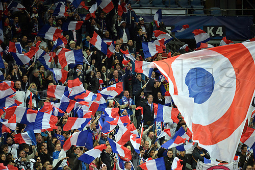 13.11.2015. Stade de France, Paris, France. International football friendly. France versus Germany.  French supporters with team flags . The game was parially interupted as the paris terror attacks took place and bombs were heard going off outside the stadium.