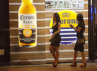 Freelance prostitutes are seen walking the street near the New Makati Club, where British ex-banker Rurik Jutting's second alleged murder victim was last seen alive in October 2014, Wan Chai, Hong Kong, China<br /> 26 October 2016.