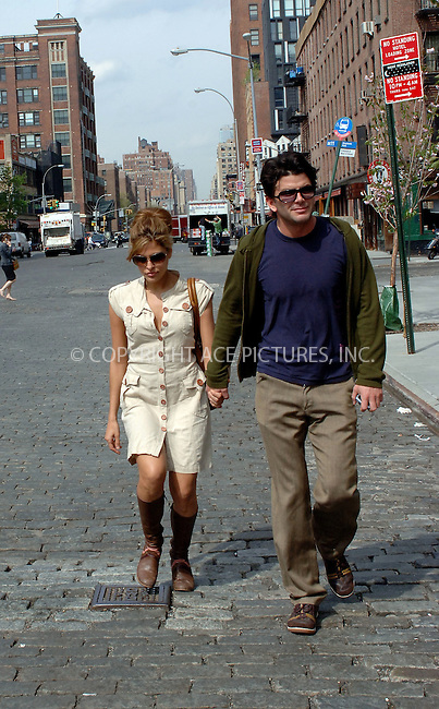 WWW.ACEPIXS.COM....April 25 2006, New York City....Actress Eva Mendes and a male friend were out and about in the Meatpacking District for some shopping, followed by a taxi ride uptown. Mendes was all smiles and even signed an autograph for a fan...........Byline:BRETT KAFFEE - ACEPIXS.COM....For information please contact:....212 243 8787 or 646 769 0430..Email: picturedesk@acepixs.com..Web: www.acepixs.com