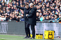 Tottenham Hotspur manager Mauricio Pochettino discusses some decisions with fourth official Lee Mason during Tottenham Hotspur vs Leicester City, Premier League Football at Wembley Stadium on 10th February 2019