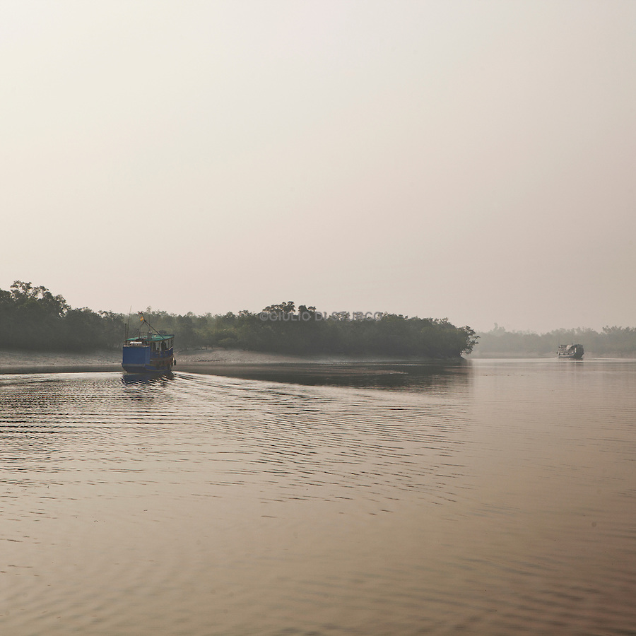 Sudhanya Khali, Unesco reserve in the Sundarban with more than 100 islands,home to the largest mangrove forest in the world. Turist boat in the sundarban, 9 December 2010...