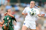 30 September 2012: UNC's Kristine Welsh-Loveman (right) blocks a clearance by Miami's Shannon McCarthy (8). The University of North Carolina Tar Heels defeated the University of Miami Hurricanes 6-1 at Fetzer Field in Chapel Hill, North Carolina in a 2012 NCAA Division I Women's Soccer game.