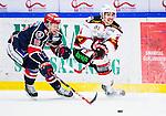 S&ouml;dert&auml;lje 2014-10-23 Ishockey Hockeyallsvenskan S&ouml;dert&auml;lje SK - Malm&ouml; Redhawks :  <br /> Malm&ouml; Redhawks Nils Bergstr&ouml;m i kamp om pucken med S&ouml;dert&auml;ljes Alexander Larsson <br /> (Foto: Kenta J&ouml;nsson) Nyckelord: Axa Sports Center Hockey Ishockey S&ouml;dert&auml;lje SK SSK Malm&ouml; Redhawks