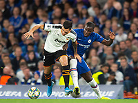 Chelsea's Kurt Zouma and Valencia Maxi Gomez during the UEFA Champions League match between Chelsea and Valencia  at Stamford Bridge, London, England on 17 September 2019. Photo by Andrew Aleksiejczuk / PRiME Media Images.