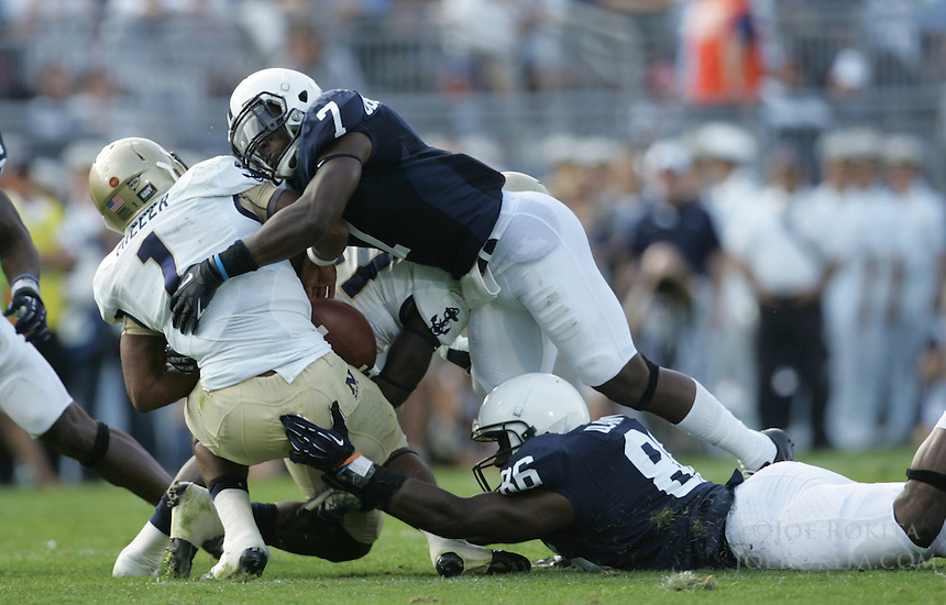 State College, PA - 09/15/2012:  Penn State Safety Stephen Obeng-Agyapong (7) causes Navy QB Trey Miller to fumble the ball.  Penn State recovered the fumble.  Penn State defeated Navy by a score of 34-7 on Saturday, September 15, 2012, at Beaver Stadium.  The win was the first for new Penn State head coach Bill O'Brien...Photo:  Joe Rokita / JoeRokita.com..Photo ©2012 Joe Rokita Photography