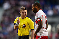 Referee Alan Kelly talks with Thierry Henry (14) of the New York Red Bulls. The New York Red Bulls and the Colorado Rapids played to a 1-1 tie during a Major League Soccer (MLS) match at Red Bull Arena in Harrison, NJ, on March 15, 2014.