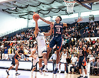 WASHINGTON, DC - NOVEMBER 16: Troy Baxter #13 of Morgan State blocks a shot by Jameer Nelson Jr. #12 of George Washington during a game between Morgan State University and George Washington University at The Smith Center on November 16, 2019 in Washington, DC.