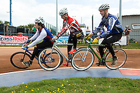 13 SEP 2014 - IPSWICH, GBR - Josh Brooke (left) from Ipswich leads Nathan Groves (centre) from Birmingham Monarchs and Olly Buxton (right) from Hethersett Hawks round the first bend during a second semi final heat at the 2014 British Open Club Cycle Speedway Championships at Whitton Sports & Community Centre in Ipswich, Great Britain (PHOTO COPYRIGHT © 2014 NIGEL FARROW, ALL RIGHTS RESERVED)