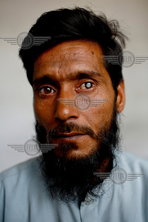A portrait of Hajir Uddin, a cataract patient at the GETA eye hospital.