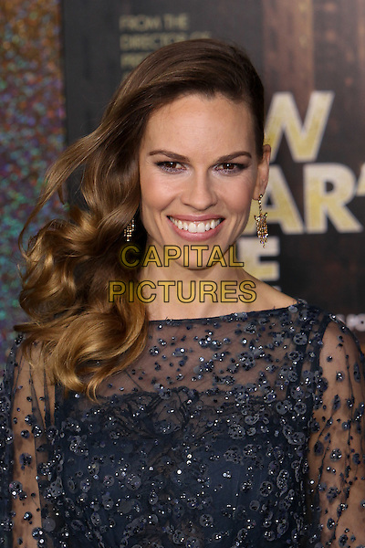 "Hilary Swank.The World Premiere of ""New Year's Eve' held at The Grauman's Chinese Theatre in Hollywood, California, USA..December 5th, 2011.headshot portrait black blue sheer beads beaded dangling gold earrings  .CAP/CEL .©CelPh/Capital Pictures."