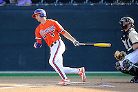 Shortstop Eli White (4) of the Clemson Tigers bats in a game against the Wofford College Terriers on Tuesday, May 5, 2015, at Russell C. King Field in Spartanburg, South Carolina. The catcher is Carson Waln. Wofford won, 17-9. (Tom Priddy/Four Seam Images)