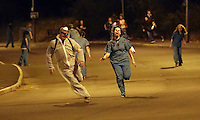 Pictured: In the final kill, Zombies chase after players in a Cardiff street. Saturday 29 March 2014<br />