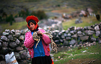 An indigenous woman winds up rope after a day of potato harvesting in the Lares Valley village of Quisuarana, Peru, on May 16, 2008. The Lares Valley contains crystal-clear lakes and unspoiled mountain vistas. The Quechua, indigenous Inca people of Southern Peru with their small villages dotting the region, also populates the network of valleys.