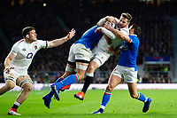 Elliot Daly of England is upended in a double-tackle from Sergio Parisse and Tito Tebaldi of Italy. Guinness Six Nations match between England and Italy on March 9, 2019 at Twickenham Stadium in London, England. Photo by: Patrick Khachfe / Onside Images