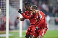 FUSSBALL   1. BUNDESLIGA  SAISON 2012/2013   21. Spieltag  FC Bayern Muenchen - FC Schalke 04                     09.02.2013 Torjubel: David Alaba und Franck Ribery (v.l., beide FC Bayern Muenchen)