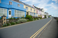 View a row of houses on the seafront at Amroth, Pembrokeshire, Wales, UK