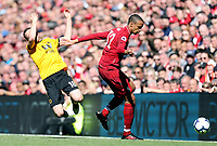 Wolverhampton Wanderers' Diogo Jota goes down under the challenge fromLiverpool's Joel Matip<br /> <br /> Photographer Rich Linley/CameraSport<br /> <br /> The Premier League - Liverpool v Wolverhampton Wanderers - Sunday 12th May 2019 - Anfield - Liverpool<br /> <br /> World Copyright © 2019 CameraSport. All rights reserved. 43 Linden Ave. Countesthorpe. Leicester. England. LE8 5PG - Tel: +44 (0) 116 277 4147 - admin@camerasport.com - www.camerasport.com