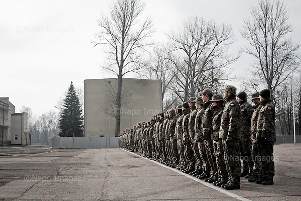 WARSAW, POLAND, 21/02/2015:<br /> Cadets of Polish paramilitary organization FIA (FIDELES ET INSTRUCTI ARMIS) during their training at the Polish army base in Warsaw. FIA consists of ordinary people of various occupations, who volunteer to learn military techniques,  and it's getting more popular because of the war in Ukraine.<br /> Seven such organization including FIA are now being endorsed by the Polish Army, which is planning to create a strong reserve army shaped like the American National Guard.<br /> (Photo by Piotr Malecki)<br /> <br /> WARSZAWA, 21/02/2015:<br /> Czlonkowie paramiliratnej organizacji FIA (Wierni w gotowosci pod bronia) podczas treninigu w jednostce wojsk pancernych w Wesolej. FIA jest jedna z siedmiu orga nizacji, ktore maja przez MON zostac polaczone w federacje i sformowac  nowe sily rezerwowe na wzor amerykanskiej Gwardii Narodowej.<br /> Fot: Piotr Malecki