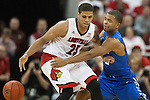 Guard Aaron Harrison of the Kentucky Wildcats steals the ball from guard Wayne Blackshear during the game against  the Louisville Cardinals at KFC Yum! Center on Saturday, December 27, 2014 in Louisville `, Ky. Kentucky defeated Louisville 58-50. Photo by Michael Reaves | Staff