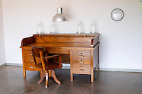 An old fashioned desk and chair in wood at the entrance. Henrque HM Uva, Herdade da Mingorra, Alentejo, Portugal