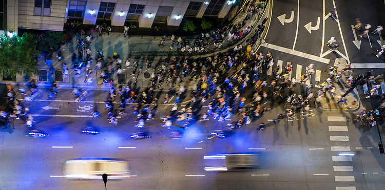 A massive crowd moves west along Grand Ave. in the Streeterville neighborhood following the annual Fourth of July fireworks at Navy Pier Tuesday, July 4, 2017. (DePaul University/Jamie Moncrief)