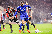Cardiff City's forward Kenneth Zohore (10)  holds off Sheffield United's defender Richard Stearman (19) during the Sky Bet Championship match between Sheff United and Cardiff City at Bramall Lane, Sheffield, England on 2 April 2018. Photo by Stephen Buckley / PRiME Media Images.
