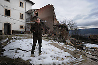 Terremoto del L'Aquila un' anno dopo. Earthquake L'Aquila one year after.Rossano Perilli, davanti le macerie della sua casa..Rossano Perilli in front of the rubble of his house....