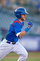 South Bend Cubs right fielder Brandon Cummins (11) runs to first base during a game against the Clinton LumberKings on May 5, 2017 at Four Winds Field in South Bend, Indiana.  South Bend defeated Clinton 7-6 in nineteen innings.  (Mike Janes/Four Seam Images)