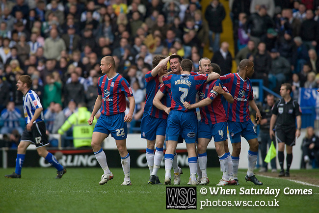 Crystal Palace players congratulating Alan Lee for scoring the game's opening goal at Hillsborough during the crucial last-day relegation match against Sheffield Wednesday. The match ended in a 2-2 draw which meant Wednesday were relegated to League 1. Crystal Palace remained in the Championship despite having been deducted 10 points for entering administration during the season.
