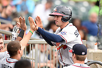 Mississippi Braves catcher Braeden Schlehuber (11) congratulated in the dugout after scoring a run during a game against the Montgomery Biscuits on April 22, 2014 at Riverwalk Stadium in Montgomery, Alabama.  Mississippi defeated Montgomery 6-2.  (Mike Janes/Four Seam Images)
