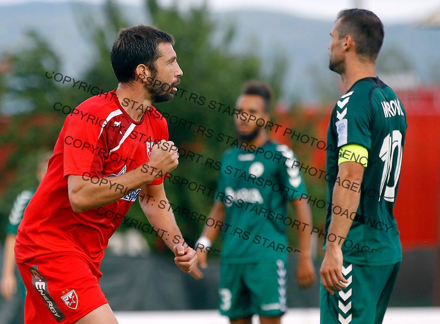 Fudbal season 2013-2014<br /> FK Crvena Zvezda pripreme<br /> Crvena Zvezda v Krka<br /> Nikola Mijailovic (L) celebrate<br /> Novo Mesto, 07.12.2014.<br /> foto: Srdjan Stevanovic/Starsportphoto &copy;