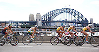 10 APR 2011 - SYDNEY, AUS - The Sydney Harbour Bridge forms the backdrop to competitors racing along the Cahill Expressway during the women's ITU World Championship Series triathlon in Sydney, Australia  (PHOTO (C) NIGEL FARROW)