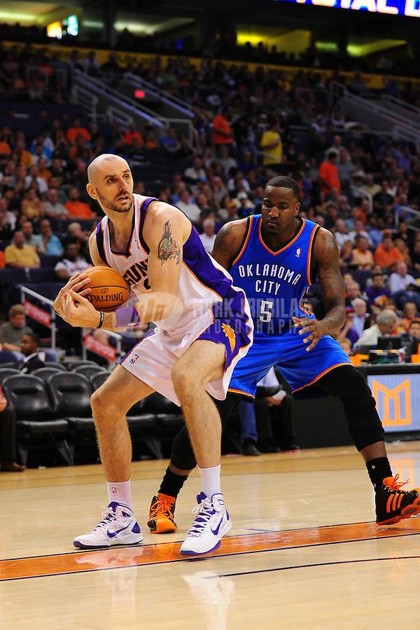 Mar. 30, 2011; Phoenix, AZ, USA; Phoenix Suns center (4) Marcin Gortat against Oklahoma City Thunder defender Kendrick Perkins at the US Airways Center. Mandatory Credit: Mark J. Rebilas-.