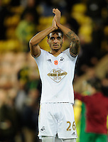 Kyle Naughton of Swansea City applauds the fans at full-time during the Barclays Premier League match between Norwich City and Swansea City played at Carrow Road, Norwich on November 7th 2015