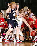 JANUARY 24, 2015 -- Logan Cowan #44 of Black Hills State tries to save the ball from out-of-bounds shadowed by Ashley Piper #13 of CSU-Pueblo during their Rocky Mountain Athletic Conference women's basketball game at the Donald E. Young Center in Spearfish, S.D. Saturday. (Photo by Dick Carlson/Inertia)