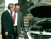 Washington, D.C. - February 20, 2007 -- Dan Elliott, President and CEO, Phoenix Motorcars, Inc., of Cucamonga, California, describes an engine in an all-electric truck to United States President George W. Bush during a demonstration of alternative fuel automobiles on the South Lawn of the White House in Washington, D.C. on Friday, February 23, 2007.<br /> Credit: Ron Sachs - Pool