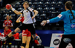 BELGRADE, SERBIA - DECEMBER 15:  Elena Avdekova of Russia (L) jump to scores past golakeeper Cecilie Greve (R) of Denmark during the Women's European Handball Championship 2012 fifth place match between Denmark and Russia at Arena Hall on December 15, 2012 in Belgrade, Serbia. (Photo by Srdjan Stevanovic/Getty Images)